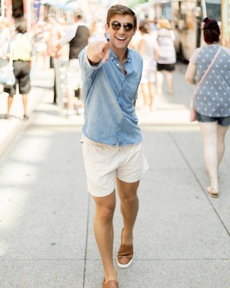 How to wear: blue chambray long sleeve shirt, white shorts, brown leather slip-on sneakers, dark brown sunglasses