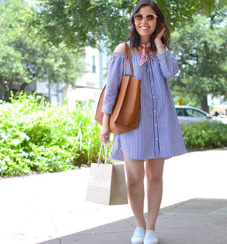 How to Wear White Slip-on Sneakers For Women: Go for a blue vertical striped off shoulder dress, if you feel like comfort dressing but would also like to look fashionable. When not sure as to the footwear, rock a pair of white slip-on sneakers.