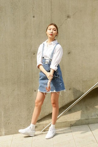 How to wear: blue denim overall dress, white dress shirt, white low top sneakers, white socks