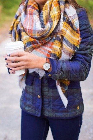How to wear: blue puffer jacket, navy skinny jeans, yellow plaid scarf