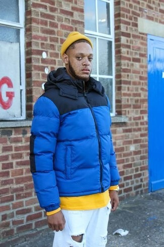 How to wear: blue puffer jacket, yellow sweatshirt, white ripped jeans, yellow beanie