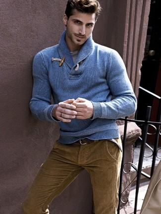 Marry a blue shawl-neck sweater with brown corduroy jeans for a comfortable outfit that's also put together nicely. An amazing transition ensemble like this one makes it so easy to welcome the new season.