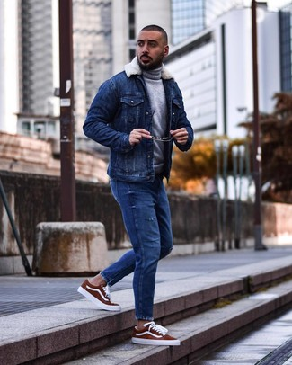 How to wear: blue denim shearling jacket, grey wool turtleneck, blue ripped jeans, tobacco suede low top sneakers