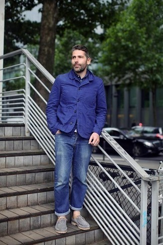 How to Wear Grey Suede Desert Boots: A blue shirt jacket looks especially nice when matched with blue jeans in a laid-back outfit. Grey suede desert boots act as the glue that pulls your getup together.