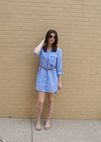 How to wear: blue vertical striped shirtdress, beige leather knee high gladiator sandals, brown leather belt, dark brown sunglasses