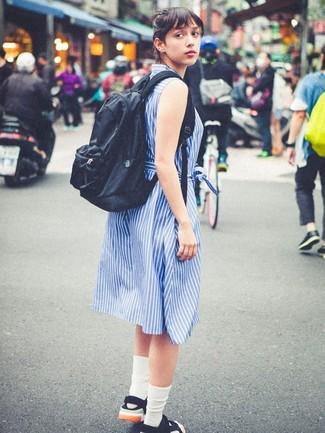 How to wear: blue vertical striped shirtdress, black canvas flat sandals, black backpack, white socks