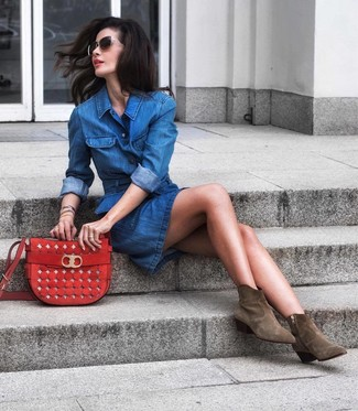 How to wear: blue denim shirtdress, olive suede ankle boots, red suede crossbody bag, black and gold sunglasses