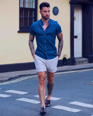 How to wear: blue denim short sleeve shirt, light blue shorts, dark brown leather tassel loafers, dark brown leather watch
