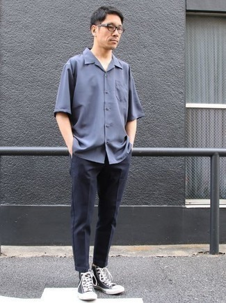 How to Wear a Blue Short Sleeve Shirt For Men: A blue short sleeve shirt and navy chinos are a wonderful combo to carry you throughout the day. For a more laid-back vibe, add navy and white canvas high top sneakers to your outfit.