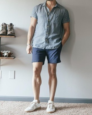White Leather Low Top Sneakers Outfits For Men: This sharp look is so simple: a blue vertical striped short sleeve shirt and navy shorts. White leather low top sneakers integrate smoothly within a great deal of looks.
