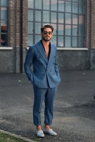 How to Wear a Black Short Sleeve Shirt For Men: Breathe personality into your current wardrobe with a black short sleeve shirt and a blue vertical striped suit. Light blue suede loafers will give an extra touch of style to an otherwise utilitarian ensemble.