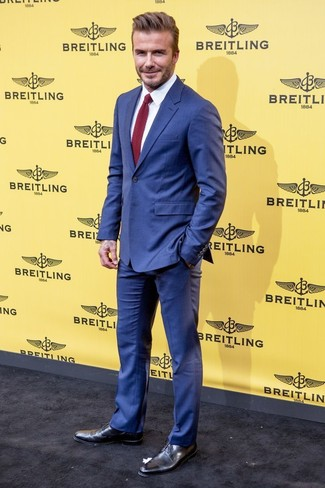David Beckham wearing Blue Suit, White Dress Shirt, Black Leather Derby Shoes, Burgundy Knit Tie