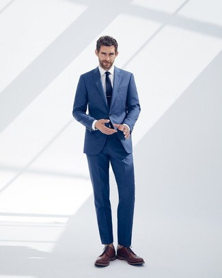 How to wear: blue suit, white dress shirt, brown leather brogues, navy tie