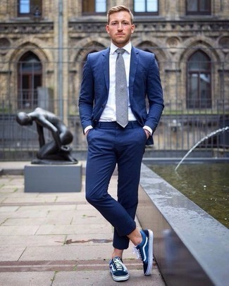 Men's Looks & Outfits: What To Wear In a Dressy Way: Consider wearing a blue suit and a white dress shirt for a sharp and elegant silhouette. To add a more casual touch to this ensemble, complete your getup with a pair of navy and white canvas low top sneakers.
