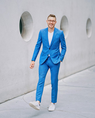 How to wear: blue suit, white v-neck t-shirt, white leather low top sneakers