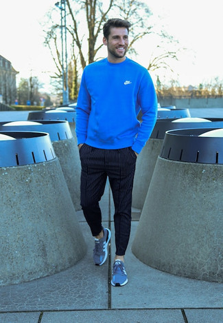 Blue Athletic Shoes Outfits For Men: This relaxed casual combo of a blue sweatshirt and navy vertical striped chinos comes in handy when you need to look good but have no time. Add a pair of blue athletic shoes to the equation to keep the getup fresh.
