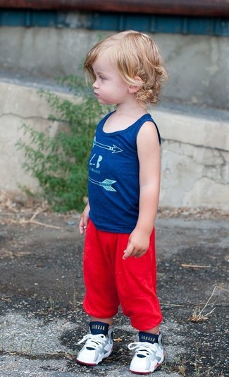 How to Wear a Blue Tank Top For Boys: People will swoon over your little angel if he wears this combo of a blue tank top and red sweatpants. White sneakers are a good choice to finish off this outfit.