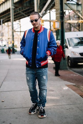 How to Wear a Blue Varsity Jacket For Men: Team a blue varsity jacket with blue ripped jeans for a cool and trendy look. A pair of black athletic shoes can integrate seamlessly within a great deal of looks.