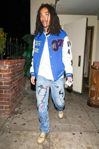 How to Wear a Blue Varsity Jacket For Men: A blue varsity jacket and light blue print jeans worn together are a match made in heaven for gentlemen who prefer off-duty styles. When it comes to footwear, this look is finished off nicely with gold leather low top sneakers.
