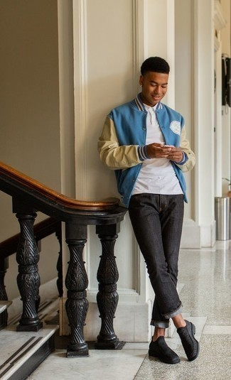 Varsity Jacket Outfits For Men: Consider pairing a varsity jacket with charcoal jeans to assemble a seriously dapper and modern-looking laid-back ensemble. A pair of charcoal canvas loafers will contrast beautifully against the rest of the look.