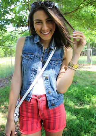 Marry a blue denim vest with red denim shorts for a standout ensemble.