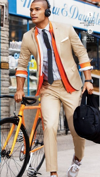 Try teaming a mustard jacket with camel dress pants like a true gent. Grey athletic shoes are the right shoes here to get you noticed.