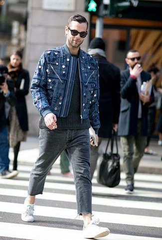 How to wear: navy embroidered bomber jacket, black cable sweater, charcoal jeans, grey low top sneakers