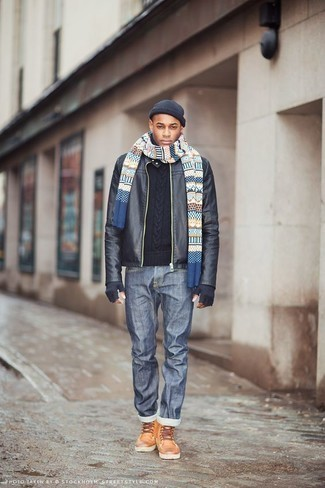 Men's Looks & Outfits: What To Wear In 2020: A black leather bomber jacket and blue jeans worn together are the perfect combo for those dressers who love neat and relaxed styles. To bring a bit of zing to this getup, complement your ensemble with a pair of tobacco leather casual boots.