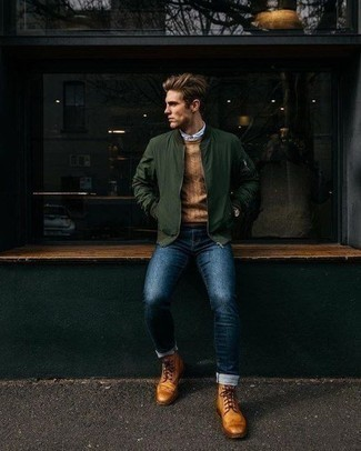 How to Wear a Dark Green Bomber Jacket For Men: A dark green bomber jacket and navy jeans are the kind of a fail-safe casual outfit that you so awfully need when you have zero time. Get a bit experimental with shoes and round off with a pair of tobacco leather brogue boots.