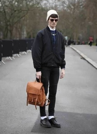 Tobacco Leather Backpack Outfits For Men: Dress in a black bomber jacket and a tobacco leather backpack for an off-duty menswear style with a twist. To give this look a sleeker touch, complete this look with black leather derby shoes.