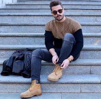 How to wear: black quilted leather bomber jacket, navy cable sweater, navy skinny jeans, tan suede work boots
