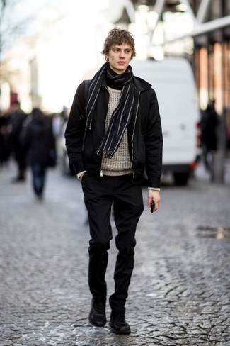 How to Wear a Black Bomber Jacket For Men: Showcase your skills in men's fashion in this off-duty combo of a black bomber jacket and black chinos. Serve a little outfit-mixing magic by sporting black suede work boots.