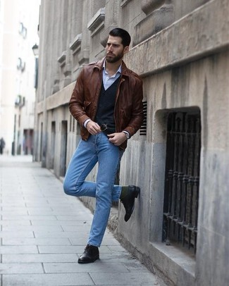 How to wear: brown leather bomber jacket, black cardigan, light blue vertical striped dress shirt, light blue jeans