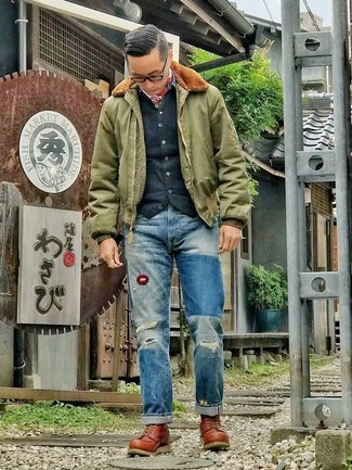 How to wear: olive bomber jacket, black cardigan, blue ripped jeans, brown leather work boots