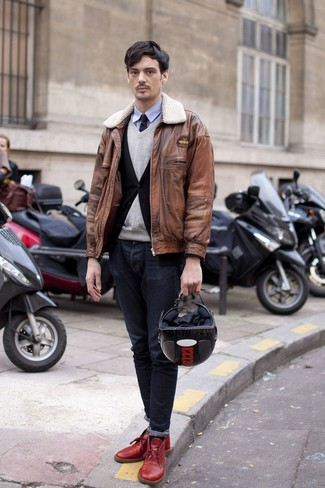 Nail off-duty dressing with this combination of a brown leather bomber and dark grey jeans. Finish off this look with red leather desert boots.