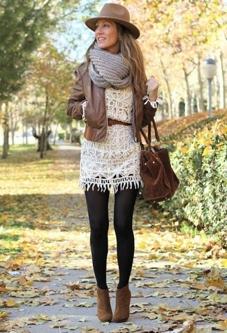 How to wear: brown leather bomber jacket, white crochet casual dress, brown suede ankle boots, brown suede tote bag