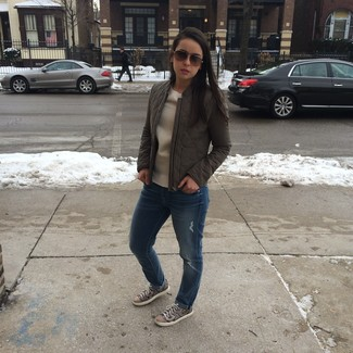 Consider wearing a nude crew-neck sweater and blue destroyed boyfriend jeans for a casual coffee run. Grey python leather low top sneakers are a wonderful choice to complete the look.