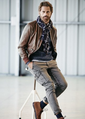 Try pairing a brown leather bomber with grey cargo pants for a comfortable outfit that's also put together nicely. Feeling inventive? Complement your outfit with brown suede chukka boots.