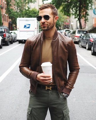 How to wear: brown leather bomber jacket, tan crew-neck sweater, dark green cargo pants, dark brown leather belt