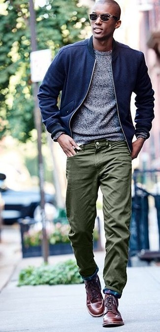 How to wear: navy wool bomber jacket, grey crew-neck sweater, olive chinos, brown leather casual boots