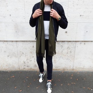 How to Wear a Black Bomber Jacket For Men: Rock a black bomber jacket with black chinos to put together a cool and relaxed outfit. A pair of olive camouflage low top sneakers adds a laid-back aesthetic to the ensemble.