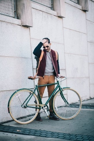 Men's Looks & Outfits: What To Wear In 2020: You'll be surprised at how extremely easy it is for any gentleman to get dressed like this. Just a burgundy bomber jacket and khaki chinos. Don't know how to round off your outfit? Wear black leather casual boots to ramp it up.