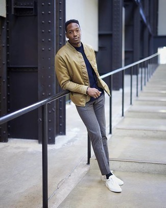 Dark Brown Bracelet Outfits For Men: Try pairing a tan satin bomber jacket with a dark brown bracelet to pull together a laid-back and stylish look. Give an elegant twist to your look by sporting white canvas low top sneakers.
