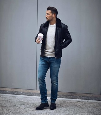 How to wear: black leather bomber jacket, grey crew-neck sweater, white crew-neck t-shirt, blue jeans