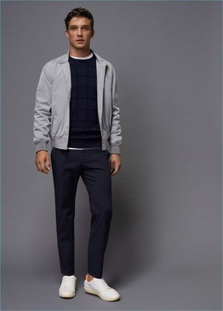 White and Red Leather Low Top Sneakers Outfits For Men: A grey bomber jacket and navy chinos are a cool outfit formula to keep in your closet. Break up this ensemble with more casual footwear, such as this pair of white and red leather low top sneakers.