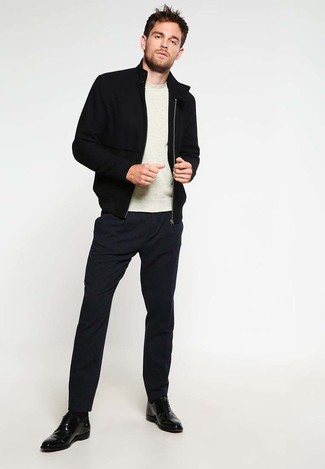 How to wear: black bomber jacket, beige crew-neck sweater, black dress pants, black leather derby shoes