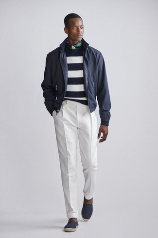 How to wear: black bomber jacket, white and black horizontal striped crew-neck sweater, white dress pants, black canvas espadrilles