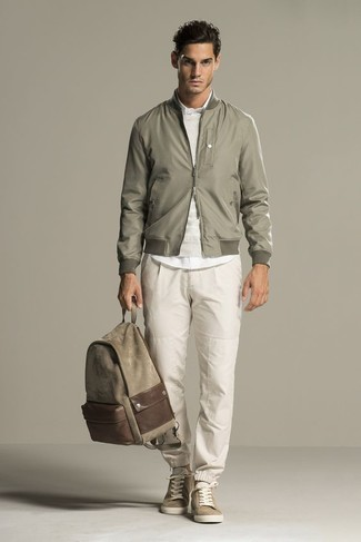 How to wear: olive bomber jacket, beige crew-neck sweater, white dress shirt, beige sweatpants