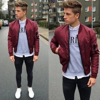 How to wear: burgundy bomber jacket, grey print crew-neck sweater, white dress shirt, black skinny jeans