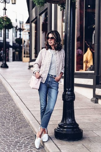 White Bomber Jacket Outfits For Women: For a casually cool look, try teaming a white bomber jacket with blue jeans — these items play really great together. Go ahead and complement this look with a pair of white leather loafers for an added dose of style.
